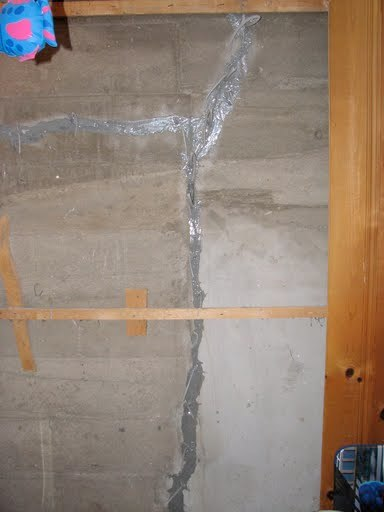 Vertical foundation crack injected
