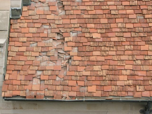 Falling stone breaks terra cotta roof
